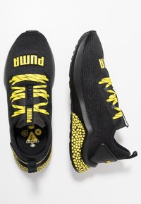 Puma - HYBRID NX CAUTION - Neutral running shoes - black/blazing yellow - 1