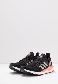 adidas Performance - ULTRABOOST 20 PRIMEKNIT RUNNING SHOES - Zapatillas de running neutras - core black/footwear white/signal coral - 2