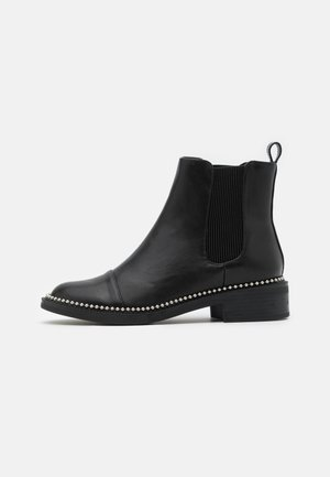 APPLE - Classic ankle boots - black
