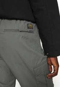 Carhartt WIP - JOGGER COLUMBIA - Cargo trousers - thyme rinsed - 5