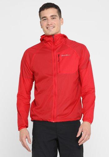 WINDSHELL - Waterproof jacket - red