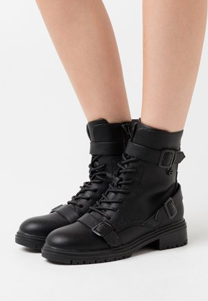 FÉLINN - Lace-up ankle boots - black