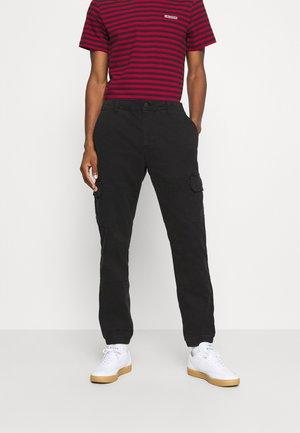 SOLYTE - Cargo trousers - noir