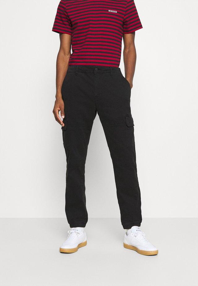 SOLYTE - Pantaloni cargo - noir