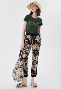 Liu Jo Jeans - Tracksuit bottoms - black with tropical print - 1
