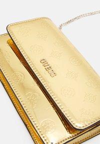 Guess - WALK OF FAME MINI XBODY FLAP - Across body bag - gold - 2
