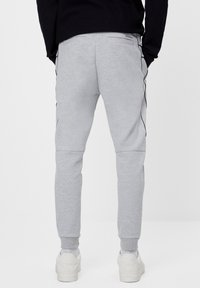 Bershka - REFLEKTIERENDE - Tracksuit bottoms - light grey - 2