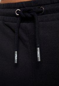 Fila - LAKIN - Tracksuit bottoms - black - 5