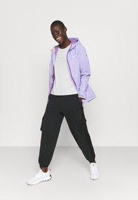 Regatta - HAMARA  - Waterproof jacket - lilac bloom - 1