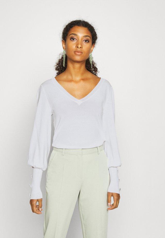 MANUELA - Strickpullover - off white