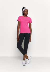 Nike Performance - ALL OVER - Camiseta básica - hyper pink/white - 1