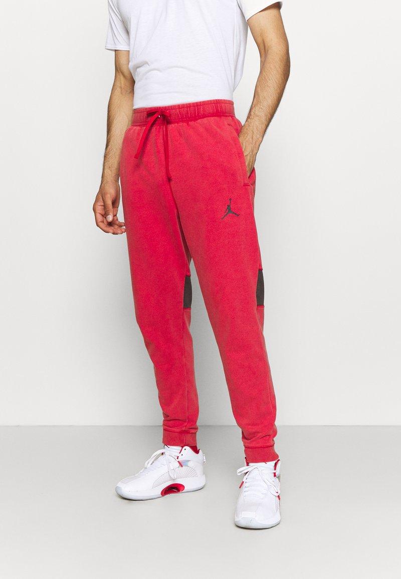 Jordan - AIR PANT - Tracksuit bottoms - gym red/black
