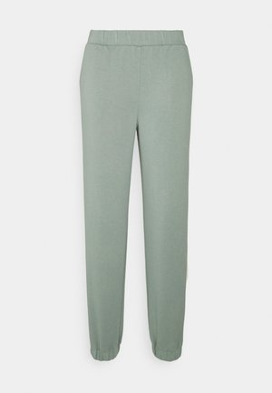 IMA PANTS - Tracksuit bottoms - chinois green