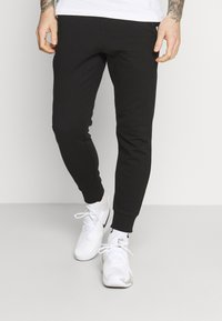 Lacoste Sport - PANT TAPERED - Pantalon de survêtement - black/navy blue - 0