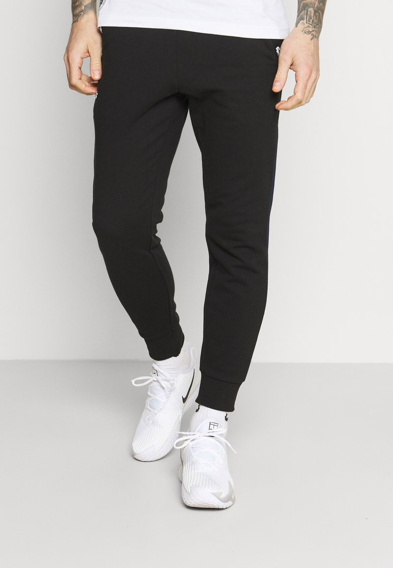 Lacoste Sport - PANT TAPERED - Pantalon de survêtement - black/navy blue
