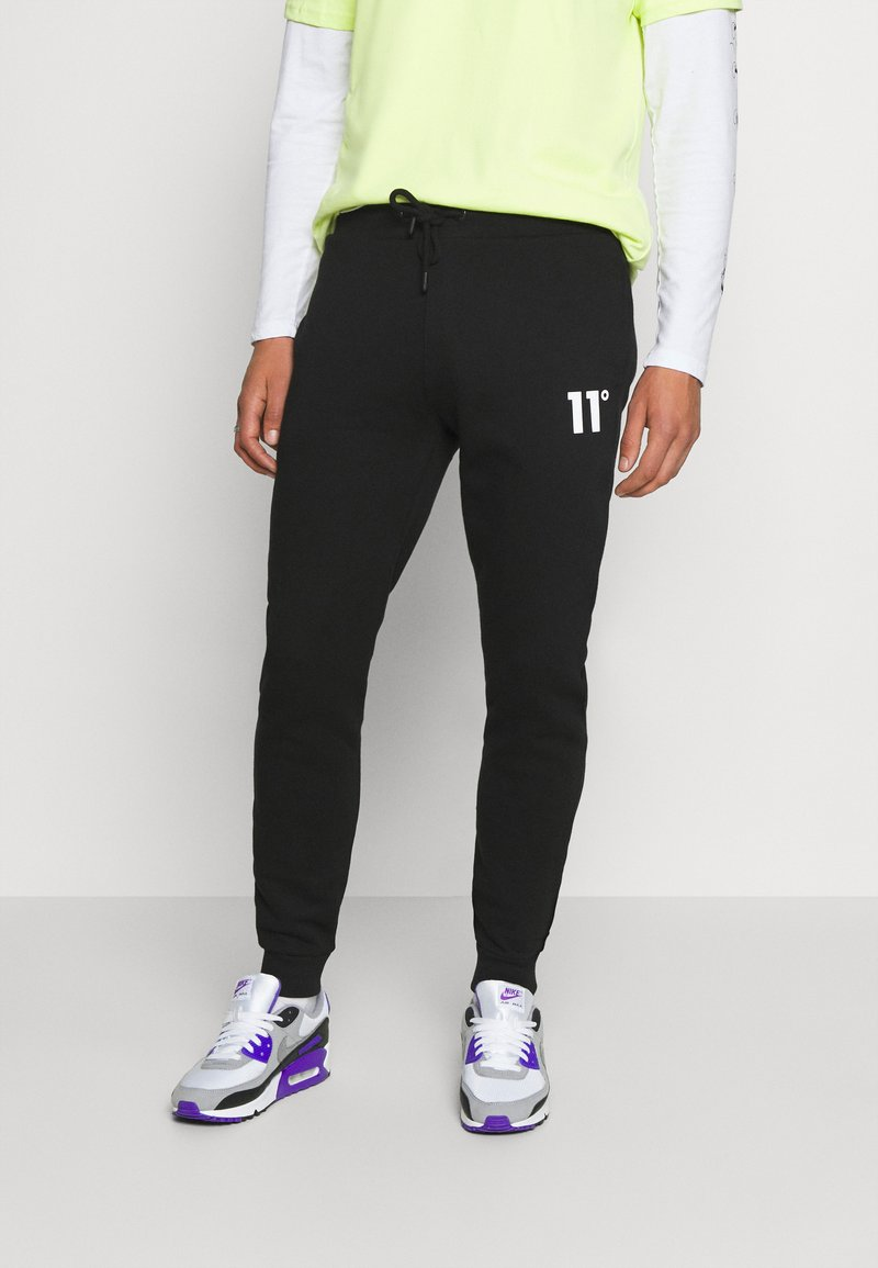 11 DEGREES - Tracksuit bottoms - black