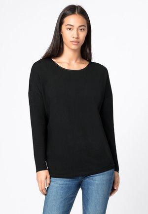 T-shirt à manches longues - schwarz