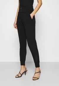 Guess - HUDA PANTS - Trousers - jet black - 0