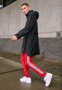 adidas Performance - URBAN RAIN.RDY - Waterproof jacket - black - 4