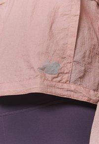 New Balance - Chaqueta de deporte - saturn pink - 4