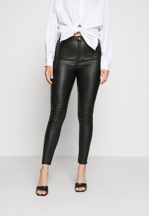 VICE HIGH WAISTED COATED SKINNY - Stoffhose - black