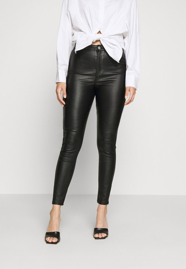VICE HIGH WAISTED COATED SKINNY - Trousers - black