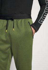 adidas Performance - TECH PANT - Tracksuit bottoms - wild pine - 3