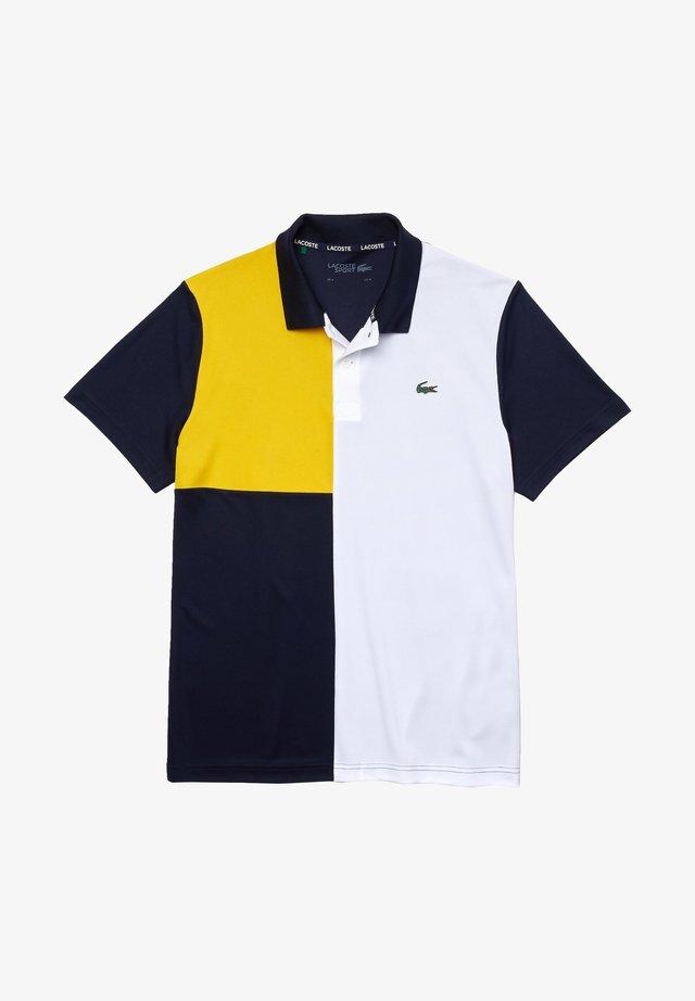 DH2103 - Polo - bleu marine / blanc / jaune