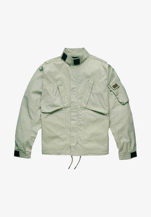 SPORTY SLANTED POCKET INDOOR - Summer jacket - beige
