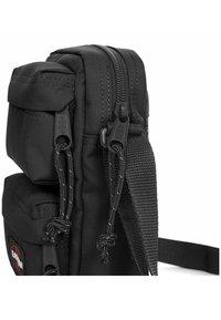 Eastpak - Across body bag - black - 2
