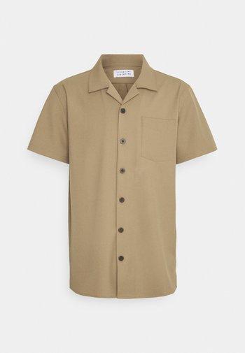 CAVE - Shirt - khaki