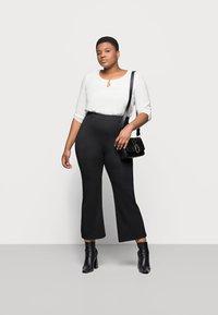 Even&Odd Curvy - Flared PUNTO trousers - Spodnie materiałowe - black - 1