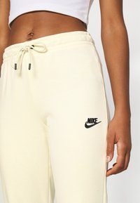 Nike Sportswear - Tracksuit bottoms - coconut milk/black - 4