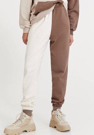 Spodnie treningowe - mottled light brown