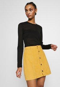 MINKPINK - LAPS AROUND THE SUN MINI SKIRT - A-line skirt - golden yellow - 3