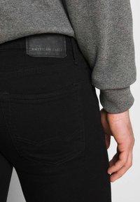 American Eagle - CLEAN - Jeans Skinny Fit - black - 3