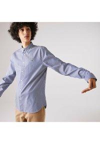 Lacoste - Shirt - weiß / blau - 1
