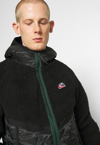 Nike Sportswear - WINTER - Winter jacket - black/pro green - 3