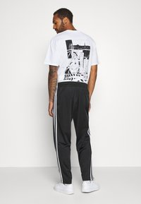 adidas Originals - Tracksuit bottoms - black/white - 2