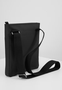 Lacoste - FLAT CROSSOVER BAG - Across body bag - black - 5