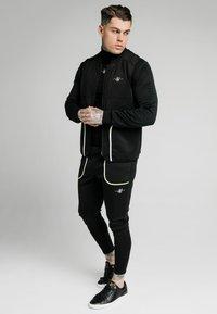 SIKSILK - Waistcoat - black & fluro white - 1