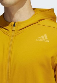 adidas Performance - AEROREADY 3-STRIPES COLD WEATHER KNIT HOODIE - Sudadera con cremallera - gold - 6