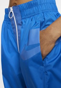 Nike Sportswear - Tracksuit bottoms - pacific blue/white - 2