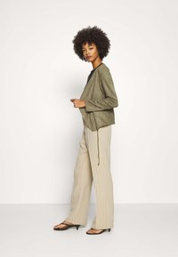 Betty & Co - Faux leather jacket - dusty olive - 1