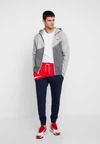 Nike Sportswear - PANT  - Tracksuit bottoms - university red/obsidian/white - 1