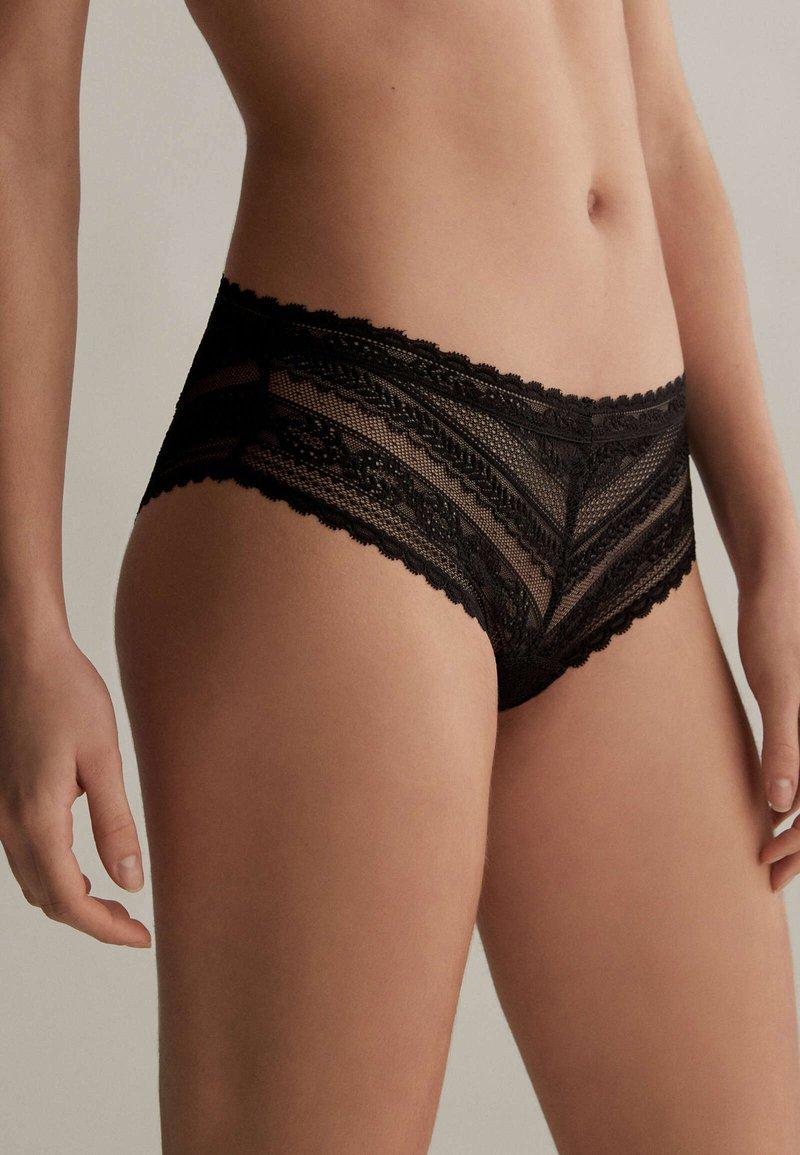 OYSHO - GEOMETRIC FLORAL - Pants - black