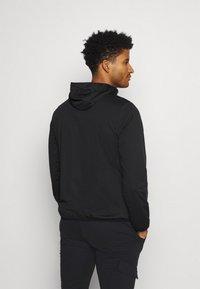 Calvin Klein Golf - ULTRON HOODED JACKET - Waterproof jacket - black - 2