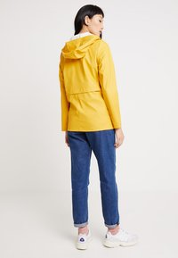 ONLY - ONLTRAIN RAINCOAT - Regenjas - yolk yellow - 2
