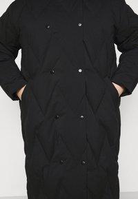 Vero Moda Curve - VMPUFFY LONG JACKET - Down coat - black - 5
