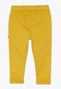Smitten Organic - BABY  - Trousers - amber yellow - 1